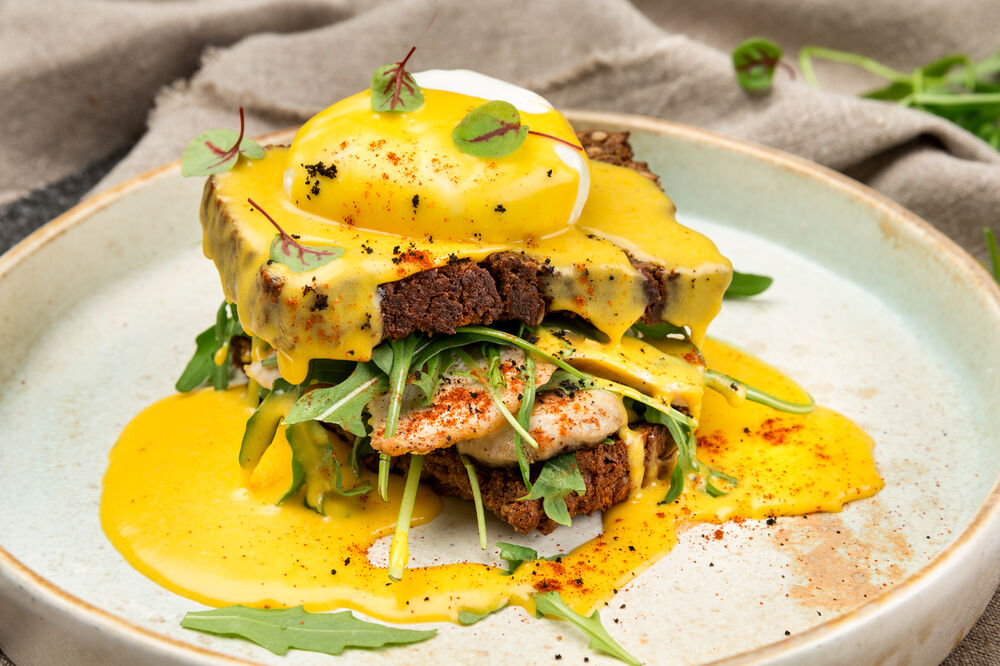 Egg Benedict with chicken and mushrooms