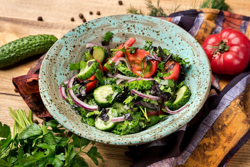 Vegetable salad Georgian style with herbs