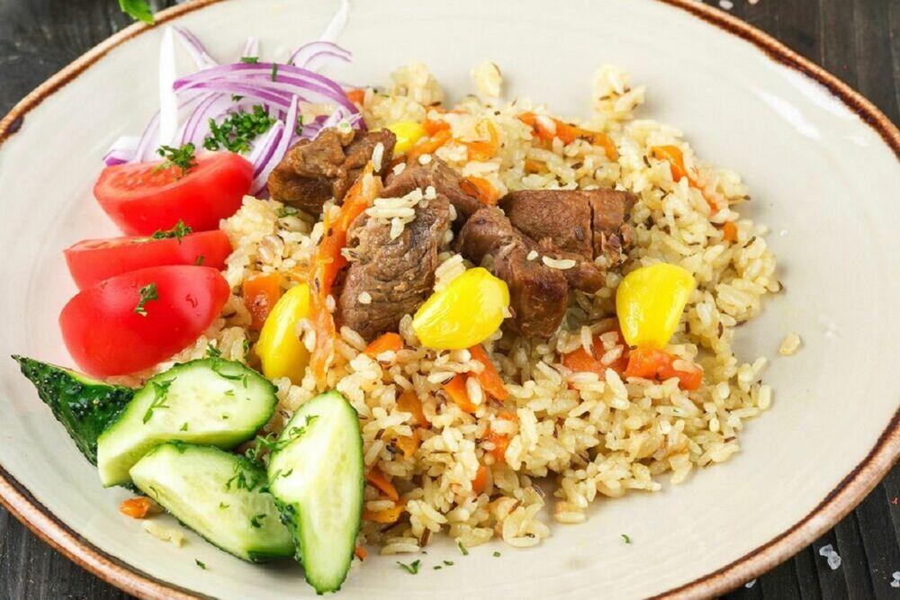 Pilaf Uzbek with fresh vegetables