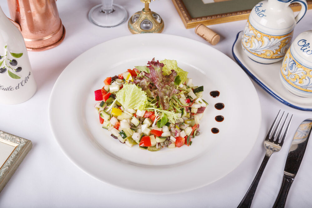 Vegetable tartare with balsamic vinegar and olives