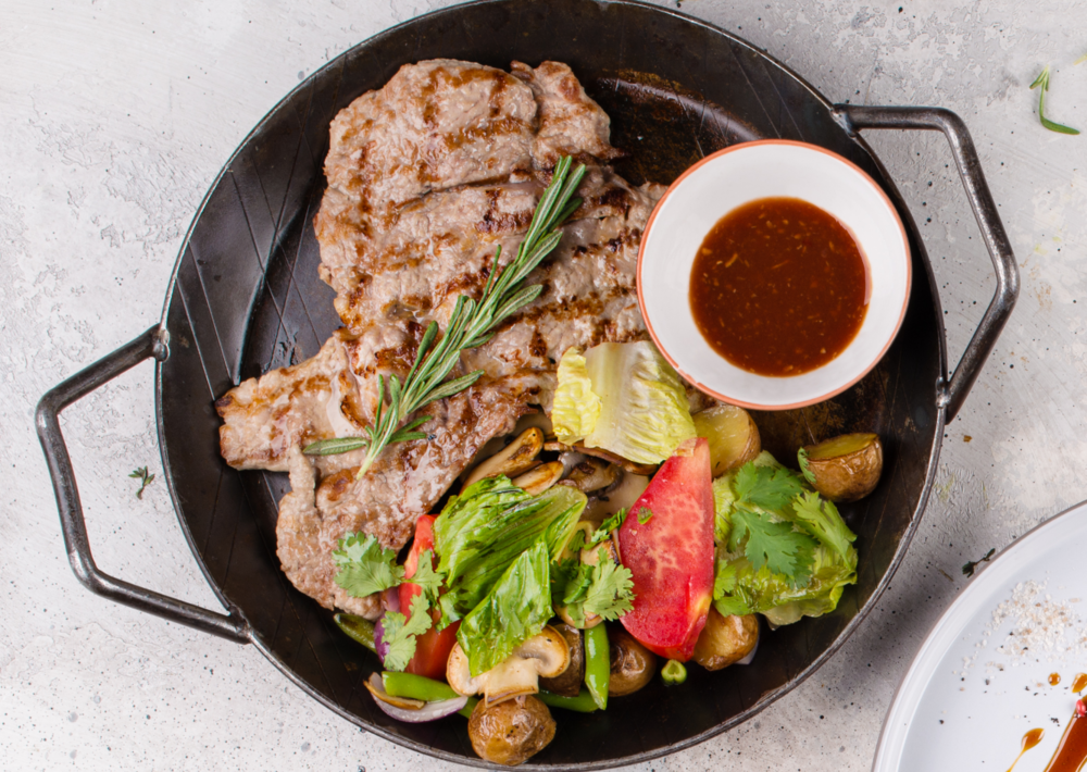Pork chop with vegetables saute
