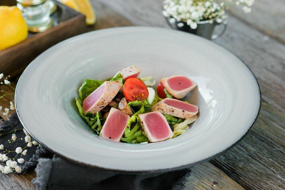 Potato salad with tuna, black olives and quail eggs.