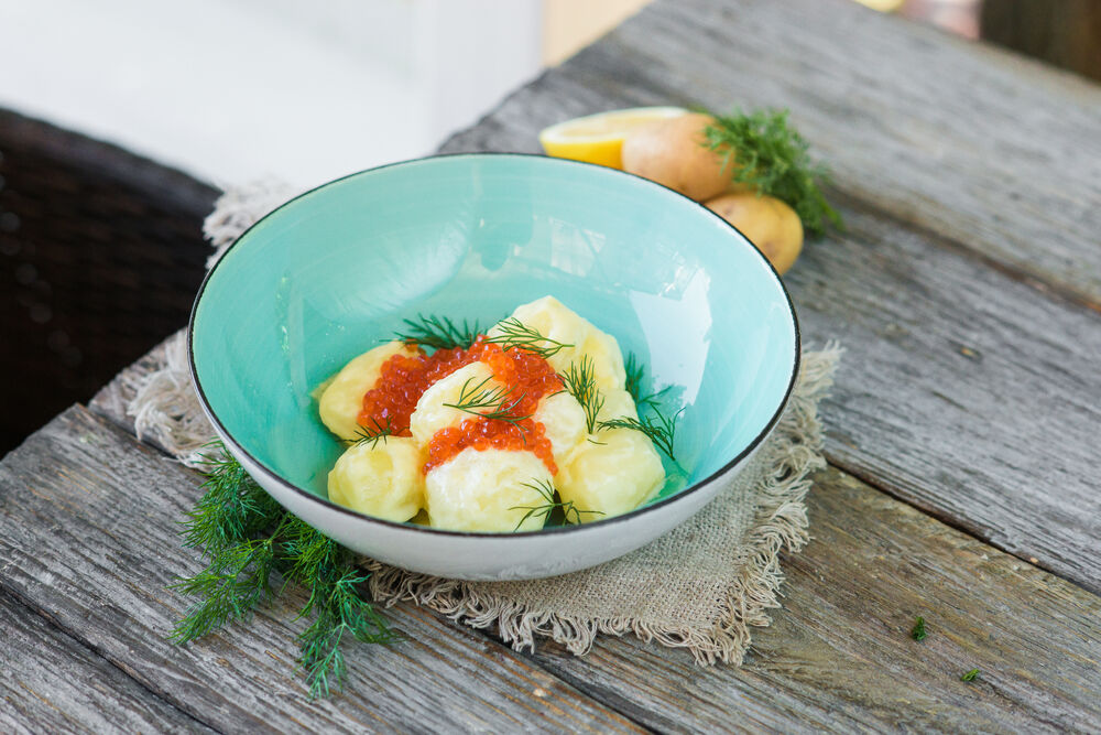 Salad with young potatoes and red caviar