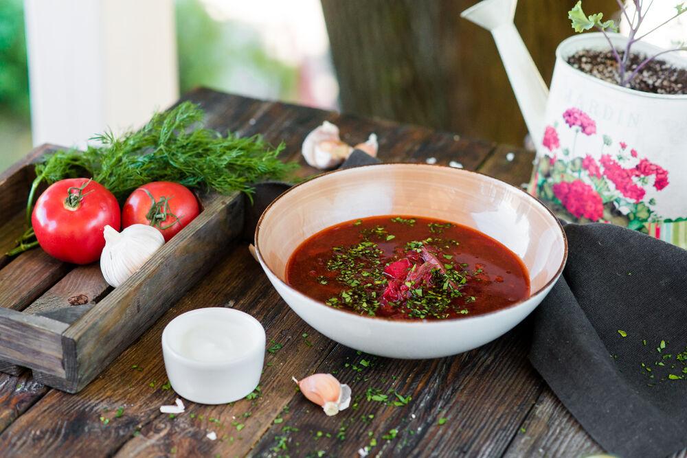 Homemade borsch with lard