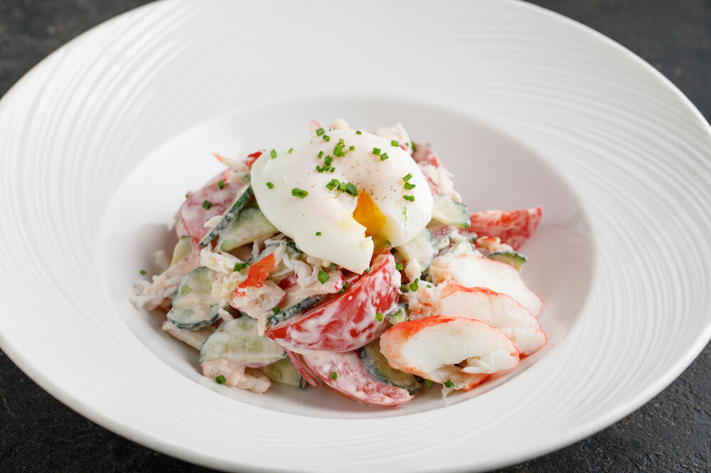 Salad with poached egg and crab